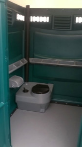 Inside of disabled toilet with extra space and support rails